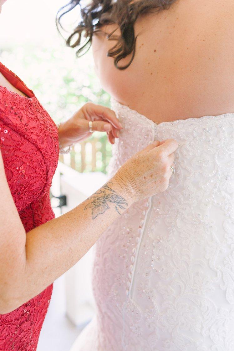 Kenneth Winston button back wedding gown